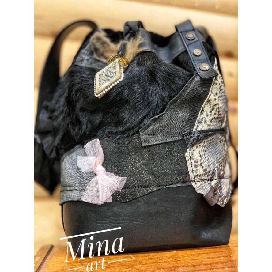 Two faces leather black handbag